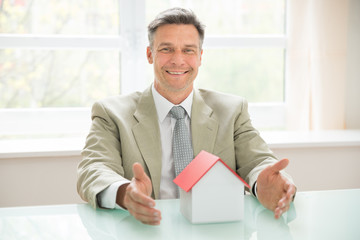 Happy Businessman With House Model