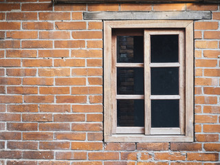 Brick wall with wooden window