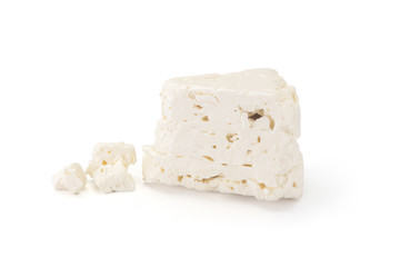 White cheese from sheep's milk on white background