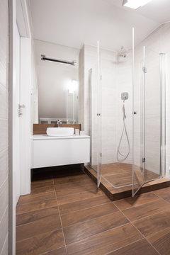White and brown washroom interior