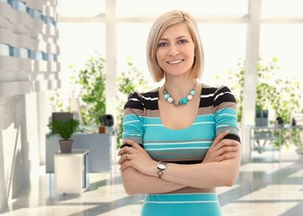 Happy blond businesswoman at office