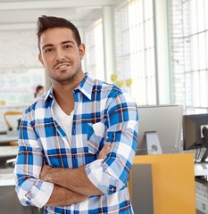 Portrait of casual man at office smiling