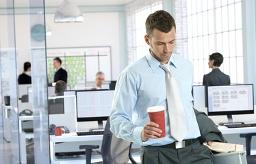 Businessman arriving to office holding coffee