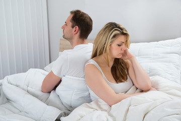 Unhappy Couple On Bed