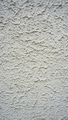 texture on white cement wall finishing vertical