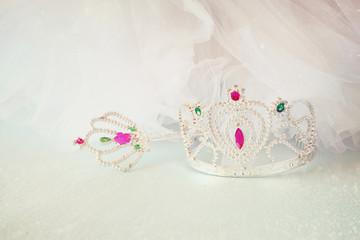 Little girls shiny crown and magic wand and chiffon dress