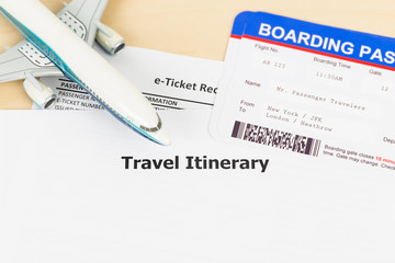 Travel itinerary with copy space, plane model, and boarding pass