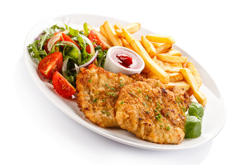 Fried pork chops, French fries and vegetables
