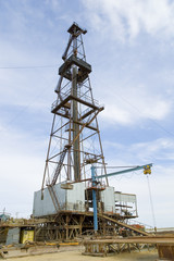 Loaded drilling rig under blue sky