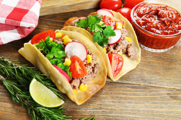 Mexican food Tacos on wooden table, closeup