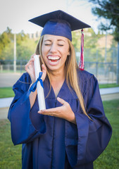 Expressive Young Woman Holding Diploma in Cap and Gown