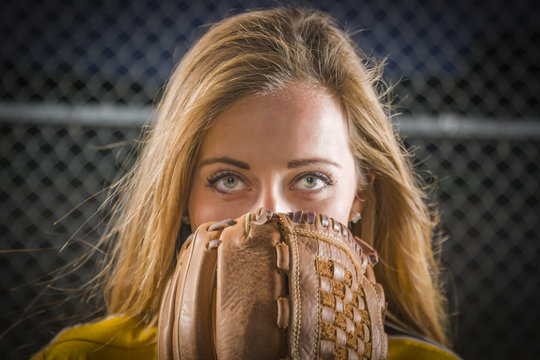 Young Woman with Softball Glove Covering Her Face Outdoors