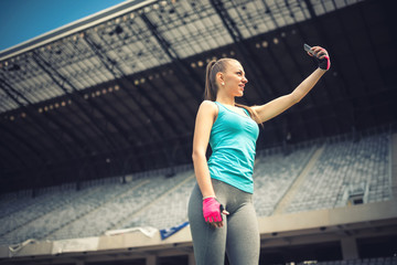 woman taking selfie with smartphone. Modern social media concept