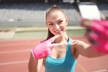 Portrait of a woman taking a selfie during training