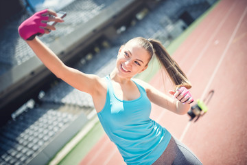 Portrait of a girl smiling and taking a selfie while training
