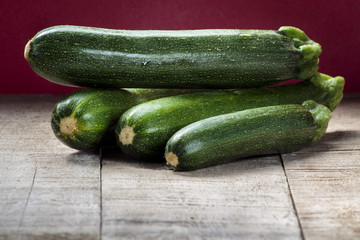 Green zucchini on wooden table