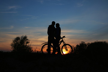 sillhouette of sweet young couple