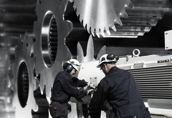 Wall Mural - industry workers with machinery, cogwheels and gear parts