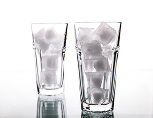 Glass with ice cubes. Isolated on white