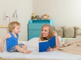 Mom reading a book son