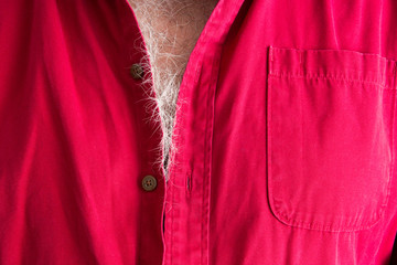 Signs of aging - grey hairs on a male chest