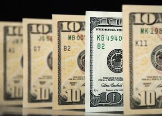 Hundred dollars among the ten dollar bills