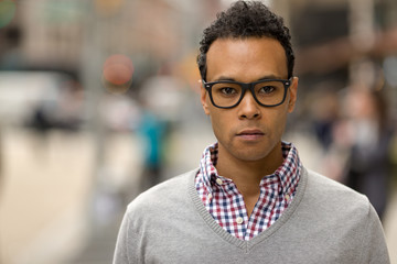 Young African Asian man in New York City serious face portrait