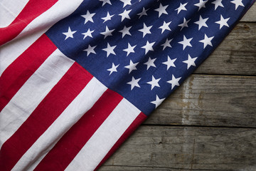 Closeup of American flag on wood background