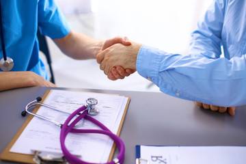 Handshake between doctor and a patient in the office