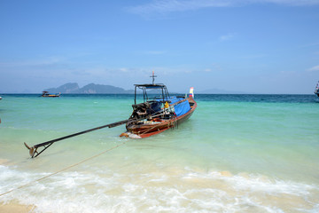 Wooden boat on the tropical beach in Thailand.