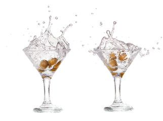 Splash from olive in a glass of cocktail, isolated