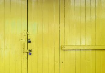 Closeup wooden yellow door background