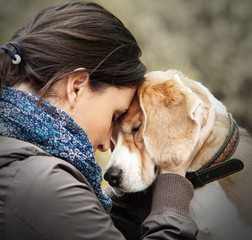 Woman with her dog tender scene