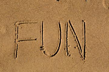 The word fun written in the sand