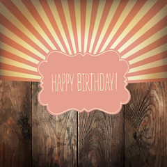 Happy Birthday greeting card with sunrays and vintage label. On