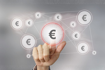 business hand pushing euro currency button