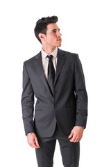 Young businessman confidently posing isolated on white