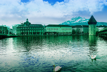 Panoramic vew of the older wooden bridge of Europe in Lucerne Sw