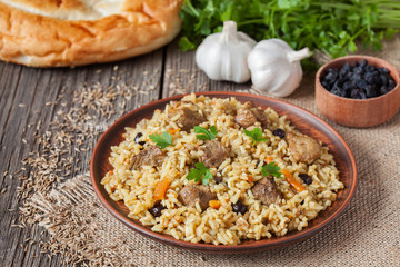 Arabic traditional rustic rice food pilaf cooked with fried meat
