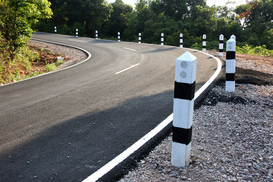 Stone pillars prevent accidents on the road curved.
