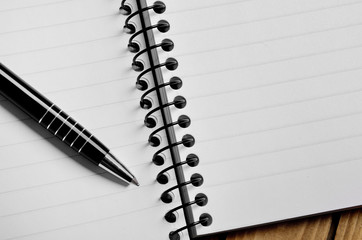 Empty notebook and pen