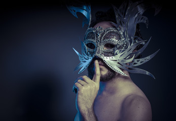 Treasure, jewels and silver. Man with mask of precious metals