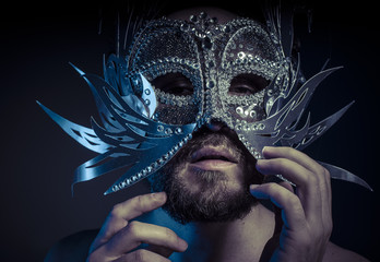 Ego, bearded man with silver mask Venetian style. Mystery and re