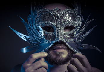 bearded man with silver mask Venetian style. Mystery and renaiss