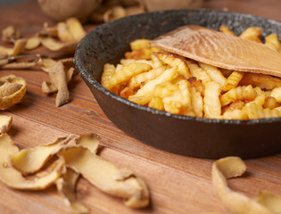 Cooking fried french potatoes composition