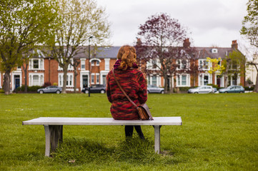 Woman resting on bench in a park