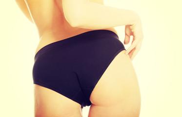 Woman bum in black panties