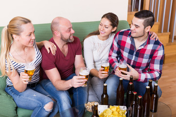 people drinking beer  and laughing