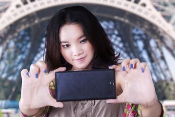 Teenage student taking a selfie in Paris