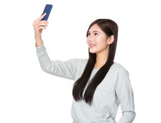Young woman take selfie